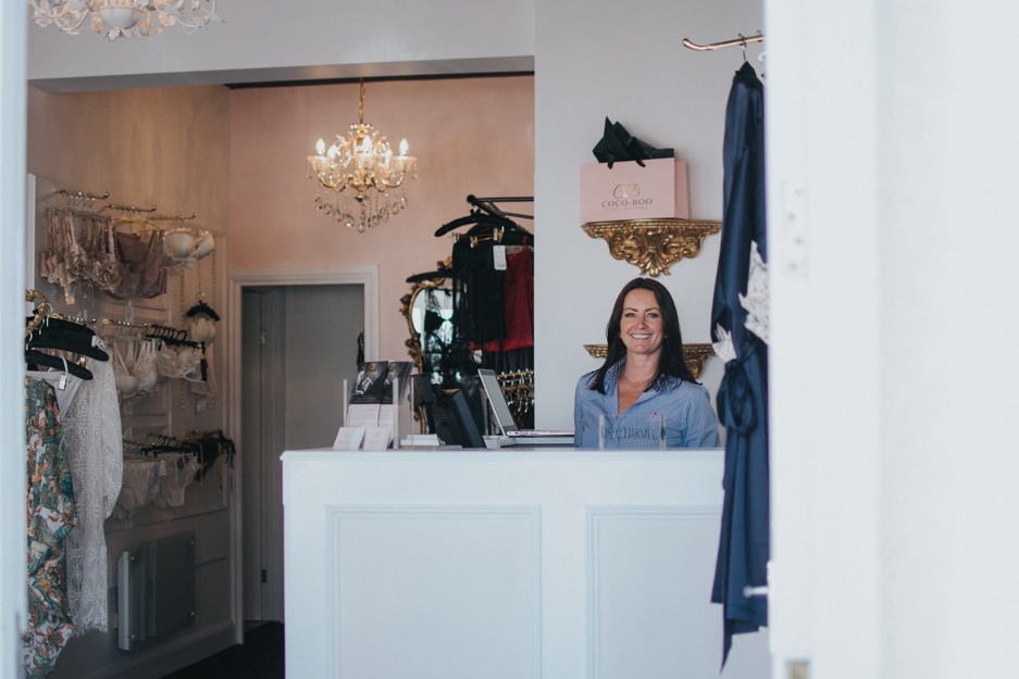 photograph of Alma Brayley-Neale behind counter of Coco Boo